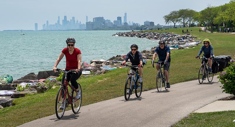 People on bikes on lakefront path, Evanston