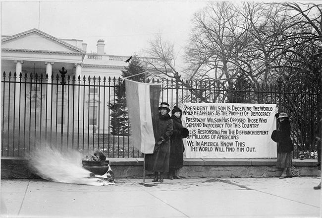 Suffragists with poster and bonfire at the White House, Washington, DC, 1918. (National Archives, Records of the U.S. Information Agency)