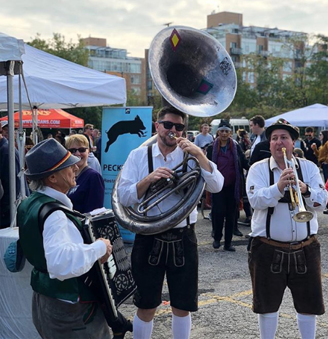 Three musicians in lederhosen at Evanston Oktoberfest